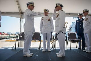 Cmdr. Joseph J. Sundland relieved Capt. Gregory D. Wisener of the duties and responsibilities as commanding officer of the Coast Guard Cutter Forward during a change of command ceremony at Base Portsmouth Friday. The change command ceremony is a revered military tradition, which formally restates the continuity and authority of command. (U.S. Coast Guard photo by Petty Officer 2nd Class Walter Shinn)