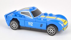 open-wheel car(0.0), race car(1.0), model car(1.0), automobile(1.0), vehicle(1.0), automotive design(1.0), shelby daytona(1.0), scale model(1.0), land vehicle(1.0), supercar(1.0), toy(1.0), sports car(1.0),