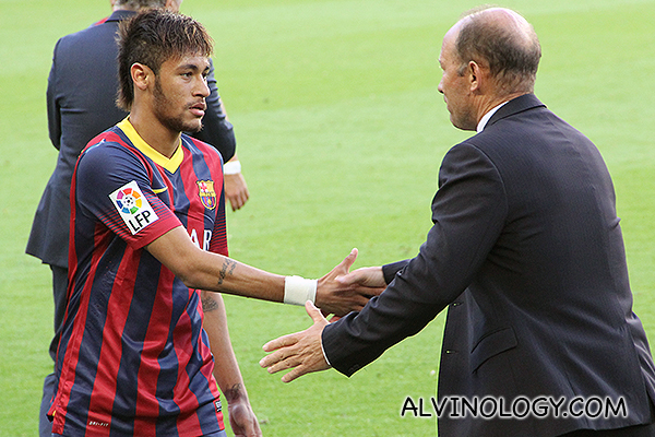 Neymar shaking hands with the Real Betis manager