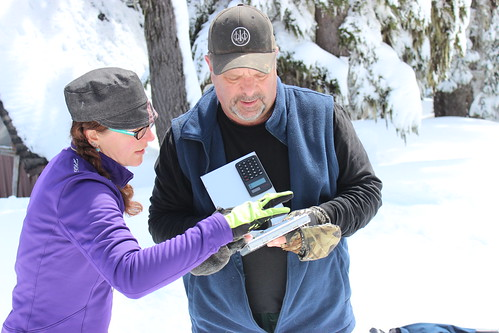 NRCS Oregon Hydrologist Julie Koeberle helps Soil Scientist Thor Thorson calculate current water content in snow. NRCS photo.
