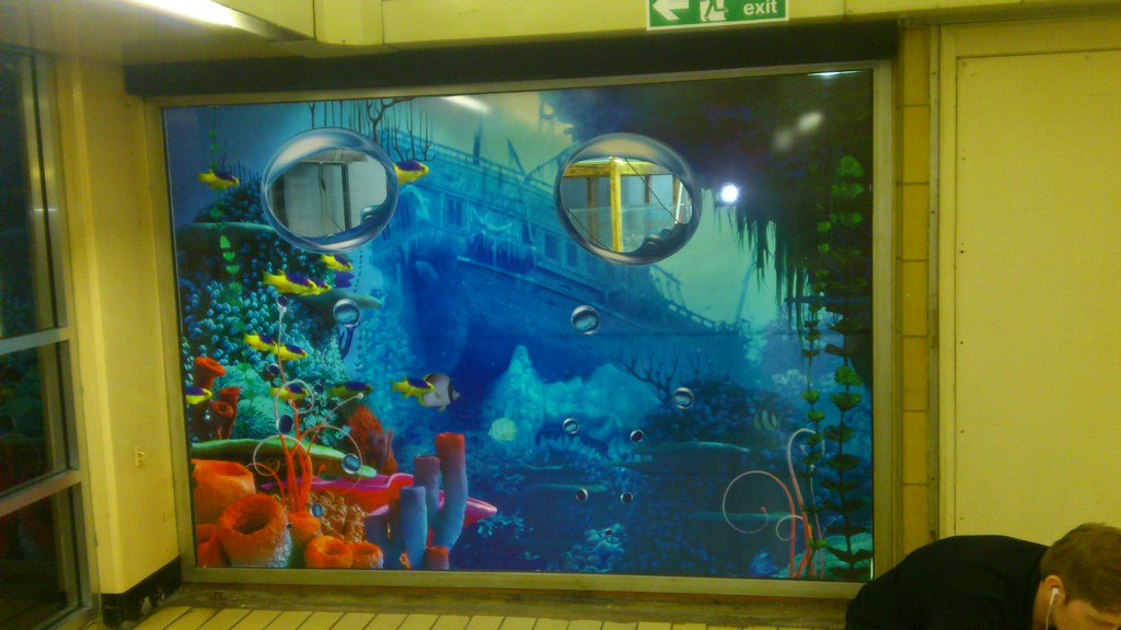 Digitally printed window wrap vinyl with cut outs to show aquarium tanks