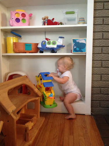 baby on the bookshelves