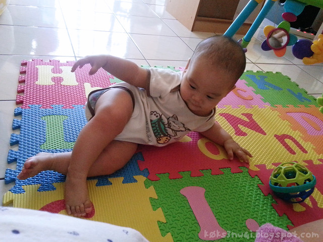 202 Days Old - Posing on Foam Playmat