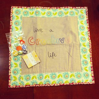 #happymail from Rachel @thefloralsuitcase for #bigstitchswap   Thank you for this beautifully embroidered mini quilt, mini charms, and buttons!  Just love the rainbow letters on linen. The needle and thread embroidery is lovely!  Thank you @sewfairyface a