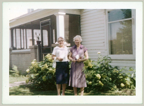 Two women in front of the house