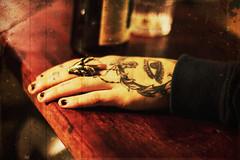 Beautifully inked devils' hand