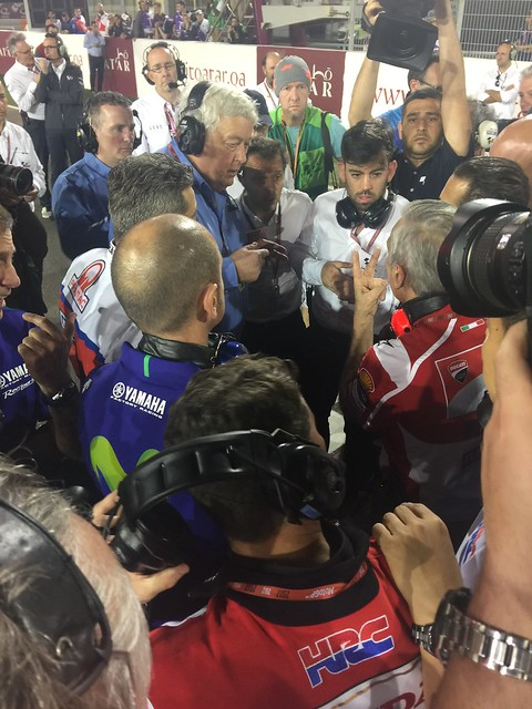 The scrum as team bosses wait for the verdict on the race start from IRTA boss Mike Trimbley and safety commission chief Loris Capirossi