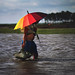Fisherman and the colorful umbrella