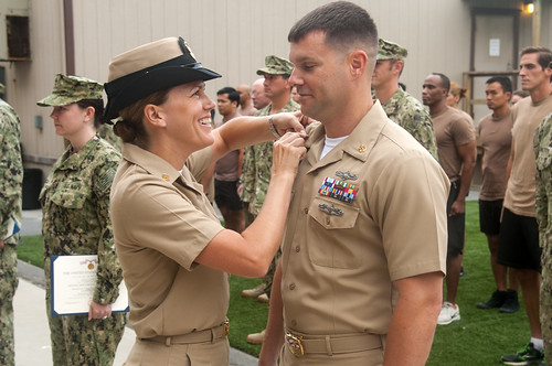 Michael and Diana Flowers are, in many ways, a typical Navy couple. They didn't meet until they were already in the Navy.  They each enlisted in 1997 and moved up the ranks in their respective career fields, Michael as a cryptologic technician (maintenance), Diane as an operations specialist.