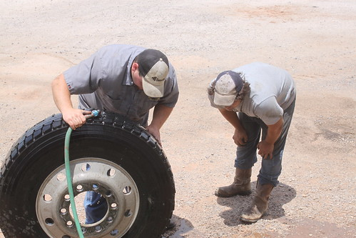 Checking for leaks on the tire.