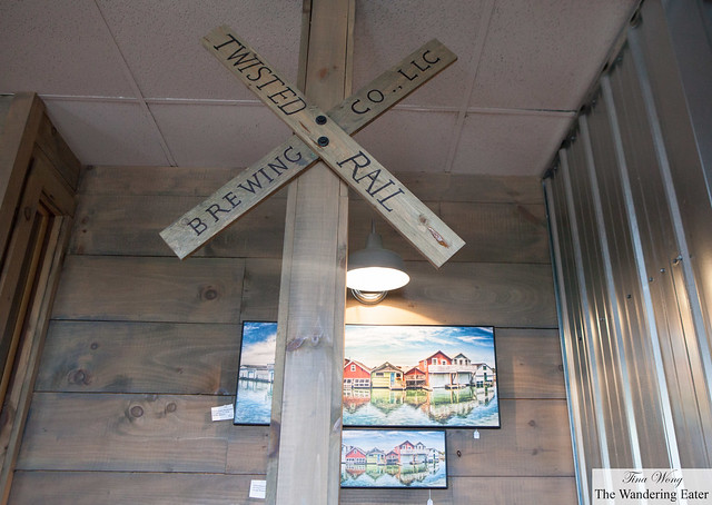 Twisted Rail Brewing Co's sign indoors and paintings of the Row Houses