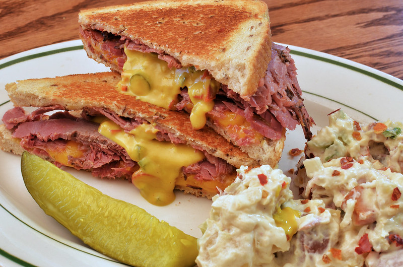 Mmm... corned beef and pastrami with cheese and hot pepper mustard