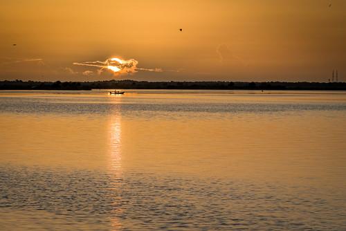 sky usa cloud reflection water sunrise river landscape dawn boat fishing florida cloudy boating titusville fishingboat centralflorida merrittislandnationalwildliferefuge minwr edrosack
