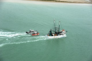 Mexican shrimping fleets departed the Port of Brownsville Thursday, Sept. 4, 2014, after 67 of the vessels gained entry for safe harbor from heavy seas caused by Tropical Storm Dolly. (U.S. Coast Guard photo by Air Station Corpus Christi)