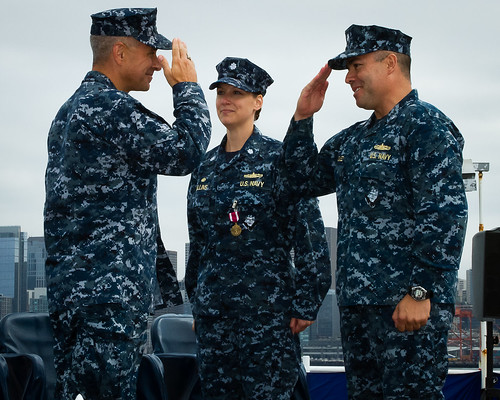 SEATTLE – The officers and crew of USS Momsen (DDG 92) stood in formation, overlooking the Seattle skyline, as Cmdr. Elaine Collins turned over command of the Arleigh Burke-class guided missile destroyer to Cmdr. Javier Gonzalez.