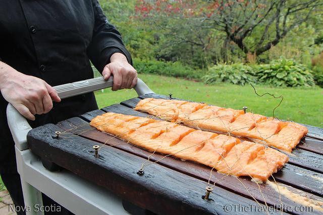 Salmon smoked on large cedar plank.