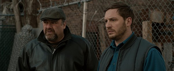 James Gandolfini and Tom Hardy face Brooklyn crime challenges in THE DROP.