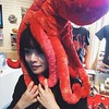 Joan with an octopus on her head.