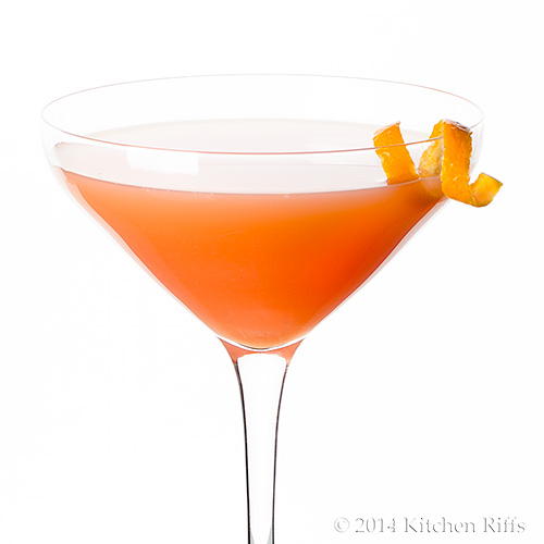 Monkey Gland Cocktail in cocktail glass with orange twist garnish