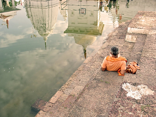 A sadhu sits on the banks of the Narmada and contemplates the river