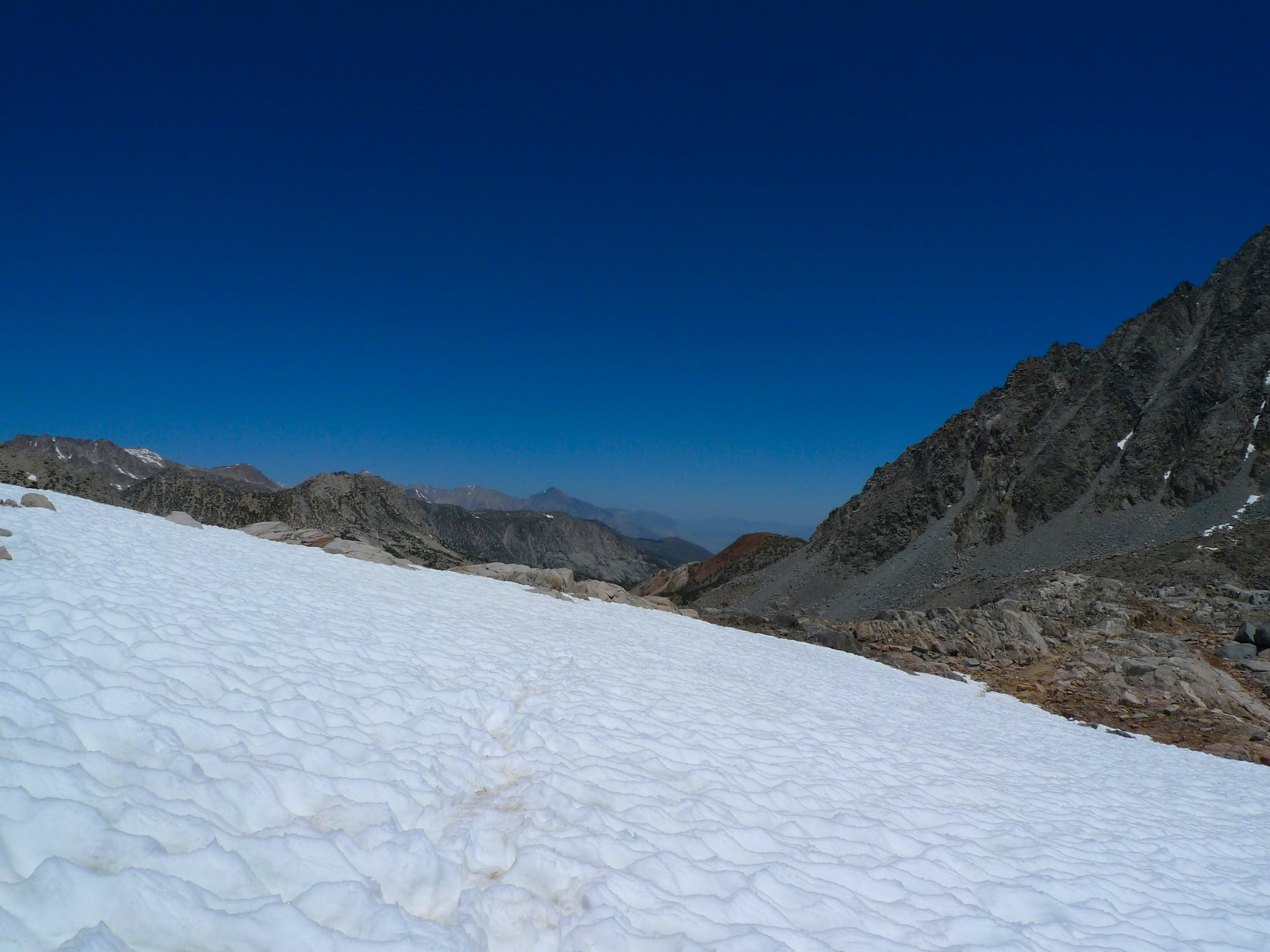 Crossing the snowfields again to descend Bishop Pass