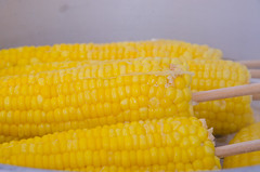 plant(0.0), fruit(0.0), dish(0.0), sweet corn(1.0), food grain(1.0), corn kernels(1.0), yellow(1.0), vegetarian food(1.0), maize(1.0), corn on the cob(1.0), produce(1.0), food(1.0), corn on the cob(1.0), cuisine(1.0),