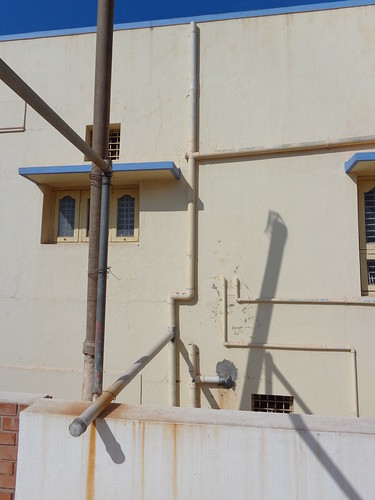 Pipes connect the neighbour and Basavaraj's rooftop