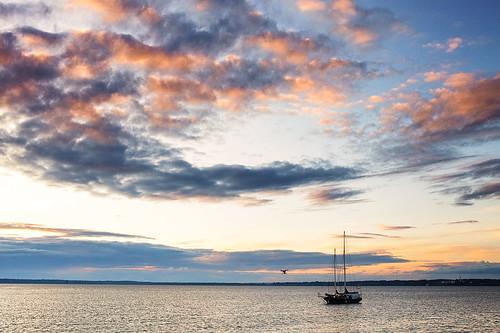 ocean sunset sky sun water colors clouds sailboat boat washington cloudy bellingham