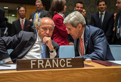 U.S. Secretary of State John Kerry chats with French Foreign Minister Laurent Fabius before chairing a United Nations Security Council meeting about Iraq in New York City on September 19, 2014. [State Department photo/ Public Domain]