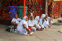 widows outside temple