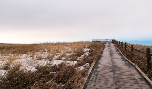 grass morning cloudcover overlook sunrise winter boardwalk cloudy nationalpark southdakota prairie snow badlandsnationalpark badlands panoramapoint fence wall unitedstates us