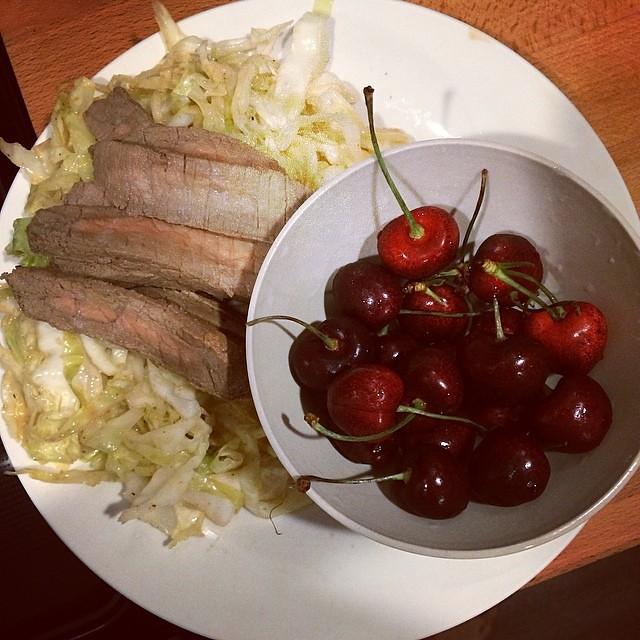 Day 4, #Whole30 - dinner (lemon butter sautéed cabbage with leftover steak strips, and cherries)