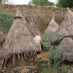 A Novice Monk Amidst Huts - Gondar, Ethiopia