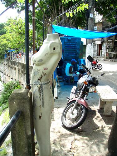 Favelas motorbike and vintage mannequin