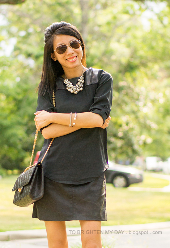 black faux leather yoke top over faux leather dress, pearl cluster necklace