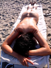 naturist beach - wife tanned body