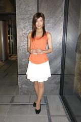 Orange top and White skirt