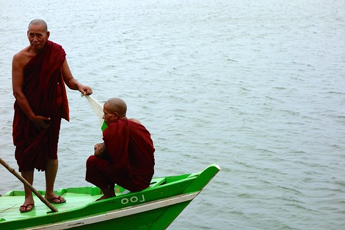 Two monks on boat in Myanmar (Inwa ferry)
