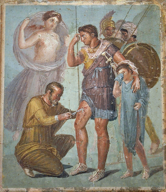 Fresco depicting Iapyx removing an arrowhead from Aeneas' thigh in the presence of Venus stands and Aeneas' young son Ascanius, from Pompeii, Naples National Archaeological Museum