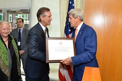 U.S. Secretary of State John Kerry thanks Ambassador Rick Barton for his service as Assistant Secretary of State for Conflict and Stabilization Operations at a farewell reception in his honor at the U.S. Department of State in Washington, D.C., on September 29, 2014. [State Department photo/ Public Domain]