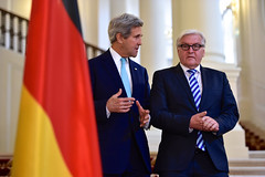 U.S. Secretary of State John Kerry and German Foreign Minister Frank-Walter Steinmeier approach reporters in a hotel in Vienna, Austria, on July 13, 2014, amid a series of P5+1 talks with Iran about its nuclear program. [State Department photo/ Public Domain]