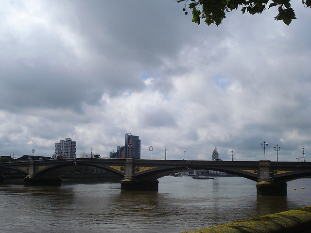 An arched bridge over a river.