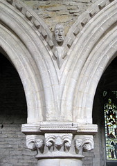 Norman capital and arch carving in the north arcade, the Church of St Michael and All Angels, Hallaton, Leicestershire, England