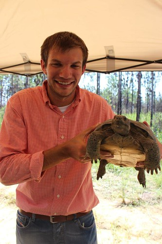 NRCS Public Affairs Specialist Justin Fritscher holds a gopher tortoise in a longleaf forest managed by The Nature Conservancy in Jackson County, Miss.