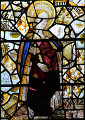 XI: Mary Magdalene: Mary holds her long hair ready to anoint Christ's feet. Probably not from this window originally.