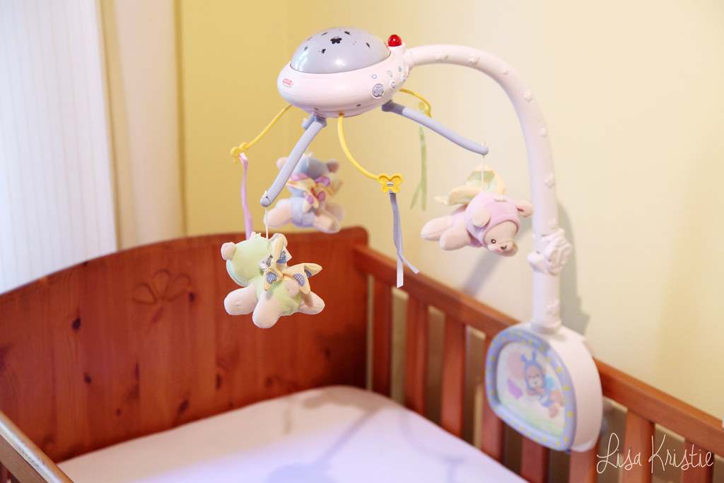cute nursery baby bed mobile crib teddy bears stuffed animals pastel colors gender neutral butterflies music light