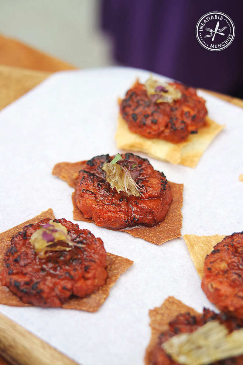 Sopressa sausage grilled and finished with a drizzle of honey, served on a wafer thin cracker.