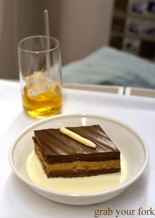 Chocolate mousse cake with vanilla creme anglaise on British Airways business class Singapore to Sydney