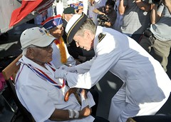 Rear Adm. Anne Cullere, commander in chief of French forces in the Pacific, presents Shuji Akiyama, a 100th Battalion veteran, the French Legion of Honor aboard the French frigate FS Prairial (F731). (U.S. Navy/MC1 David Kolmel)