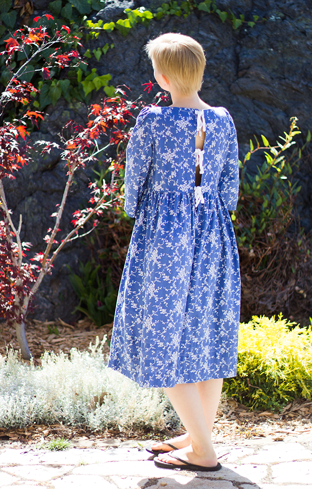 tea-length floral blue dress that ties in the back